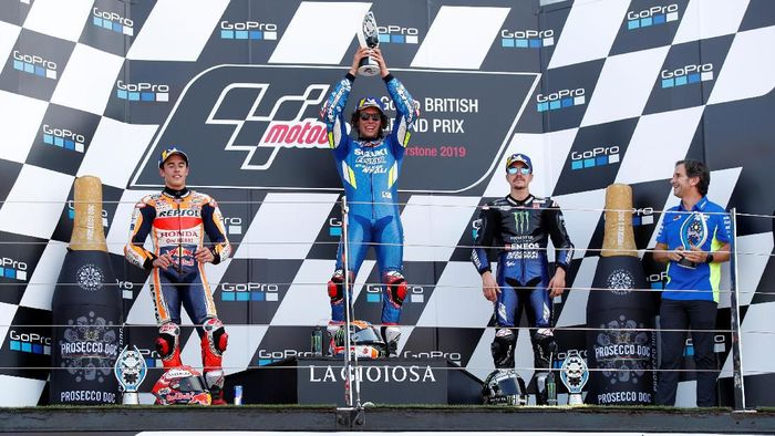 MotoGP - British Grand Prix - Silverstone Circuit, Silverstone, Britain - August 25, 2019  Team Suzuki Ecstars Alex Rins celebrates on the podium after winning the race with Repsol Hondas Marc Marquez who finished second and Monster Energy Yamahas Maverick Vinales who finished third  REUTERS/David Klein