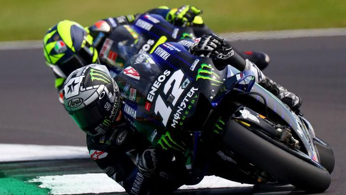 NORTHAMPTON, ENGLAND - AUGUST 25: Maverick Vinales of Spain and Monster Energy Yamaha MotoGP rides ahead of Valentino Rossi of Italy and Monster Energy Yamaha MotoGP at Silverstone Circuit on August 25, 2019 in Northampton, England. (Photo by Dan Istitene/Getty Images)