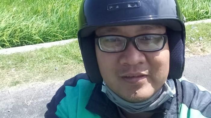 Driver ojol ini ceritakan kisahnya yang sedang viral di medsos. (Foto: dok. pribadi.)