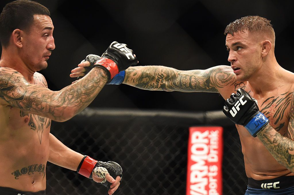 ATLANTA, GEORGIA - APRIL 13: Dustin Poirier punches Max Holloway during the UFC 236 event at State Farm Arena on April 13, 2019 in Atlanta, Georgia. (Photo by Logan Riely/Getty Images)