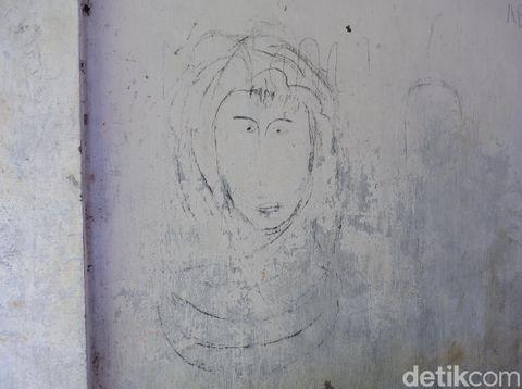 Coretan dinding di Kampung 'HIlang' di Banyuwangi/