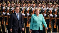 Angela Merkel Desak Agar Perang Dagang AS-China Segera Diakhiri