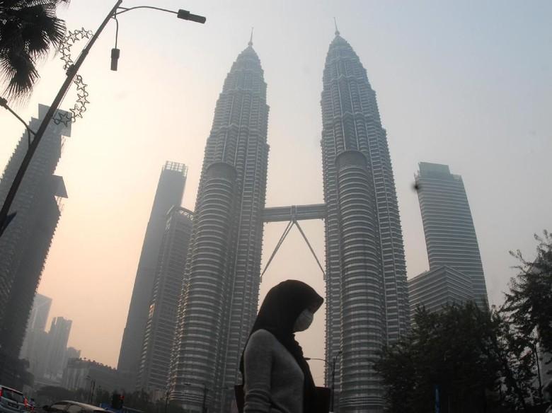 Kabut Asap, Mahathir Akan Tindak Tegas Perusahaan Malaysia di Indonesia