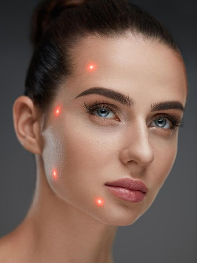 Cometology. Closeup Of Beautiful Sexy Woman Face With Smooth Skin And Perfect Makeup. Portrait Of Girl Before Plastic Surgery With Laser Marks On Facial Skin. Cosmetic Treatment. High Resolution