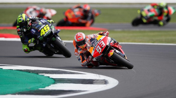 MotoGP - British Grand Prix - Silverstone Circuit, Silverstone, Britain - August 25, 2019  Repsol Hondas Marc Marquez and Monster Energy Yamahas Valentino Rossi in action during the race  REUTERS/David Klein
