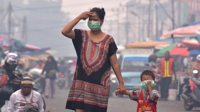 Ibu hamil dan bayi rentan terhadap kabut asap akibat karhutla. (Foto: ANTARA FOTO/FB Anggoro)