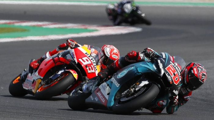Frances Fabio Quartararo, right, steers his motorcycle has Spains Marc Marquez rides behind in the MotoGP race during the San Marino Motorcycle Grand Prix at the Misano circuit in Misano Adriatico, Italy, Sunday, Sept. 15, 2019. (AP Photo/Antonio Calanni)
