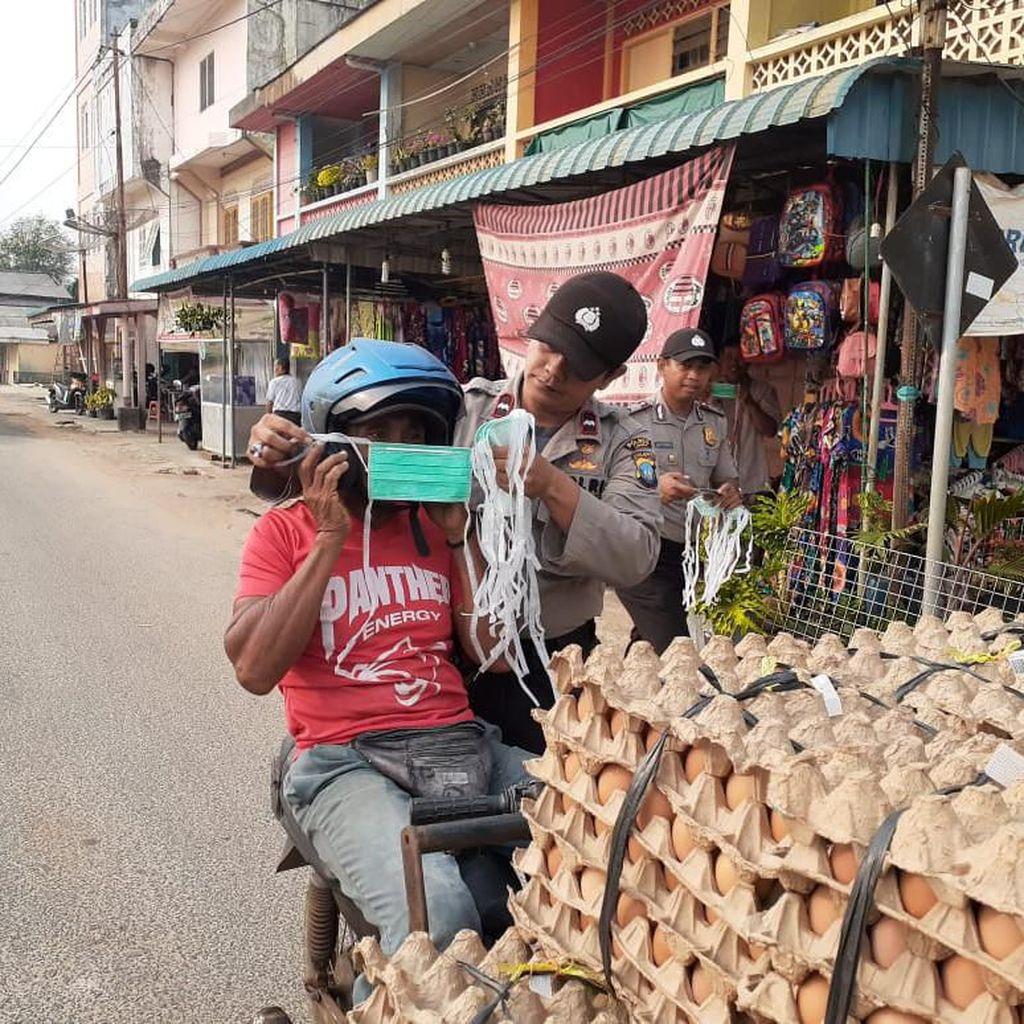 Kabut Asap Sampai ke Kepulauan Riau, Polisi Bagikan Masker