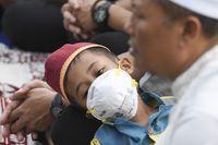 Contoh masker N95 untuk melindungi pernapasan dari kabut asap