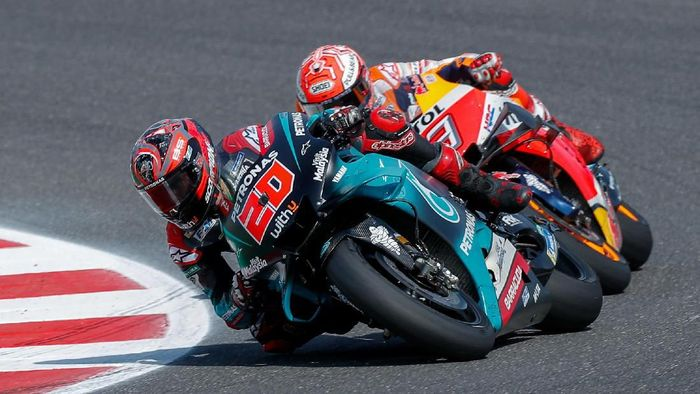 Motorcycling - MotoGP - San Marino Grand Prix - Misano World Circuit Marco Simoncelli, Misano Adriatico, Italy - September 15, 2019  Petronas Yamaha SRTs Fabio Quartararo and Repsol Hondas Marc Marquez in action during the race  REUTERS/Rafael Marrodan/Photocall3000