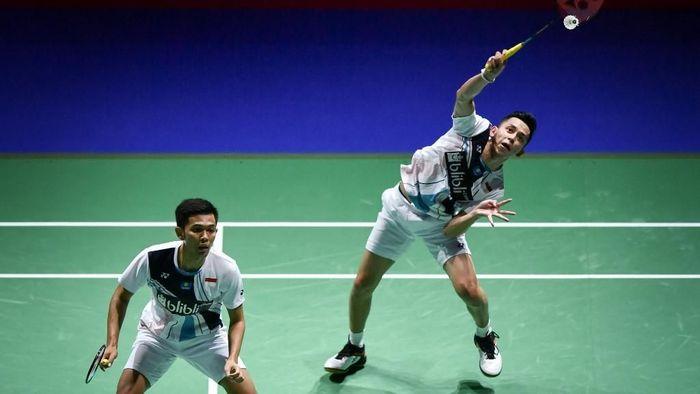 Fajar Alfian/Muhammad Rian Ardianto akan tampil di semifinal Korea Open 2019 (Foto: Fabrice Coffrini/AFP)