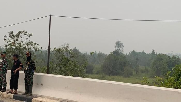 Ilustrasi Petugas Atasi Karhutla di Kalimantan (Foto: Istimewa)