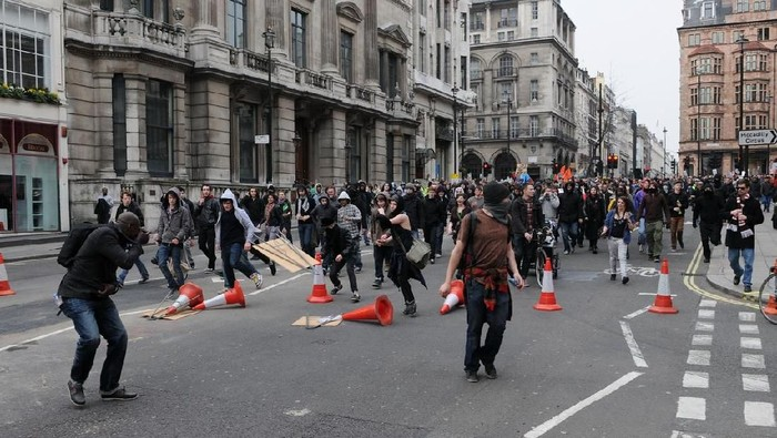 London, UK - March 26, 2011: A breakaway group of protesters march through the streets of the British capital during a large austerity rally.