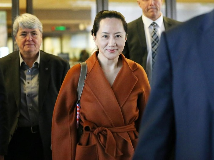 VANCOUVER, BC - SEPTEMBER 23: Huawei Technologies Co. Chief Financial Officer Meng Wanzhou leaves the British Columbia Superior Courts at lunch hour on September 23, 2019 in Vancouver, Canada. Wanzhou was arrested by Canadian authorities last December on fraud charges and faces extradition to the United States. (Photo by Karen Ducey/Getty Images)