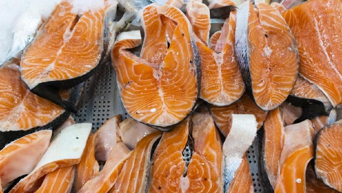Raw fillets of red fish, salmon, cooking healthy diet dishes for dinner