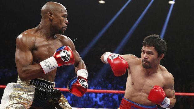 Floyd Mayweather saat bertarung melawan Manny Pacquiao. (