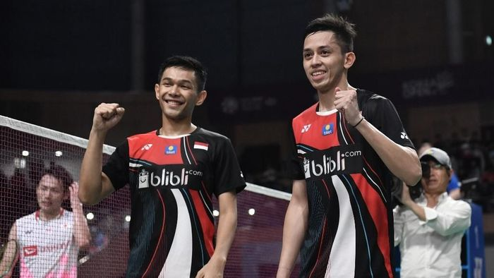 Fajar Alfian/Muhammad Rian Ardianto berhasil menjuarai Korea Open 2019. (Foto: Jung Yeon-jae / AFP)