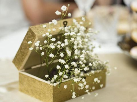 Close-up shot of bunch of baby's breath flowers in a box on the table.
