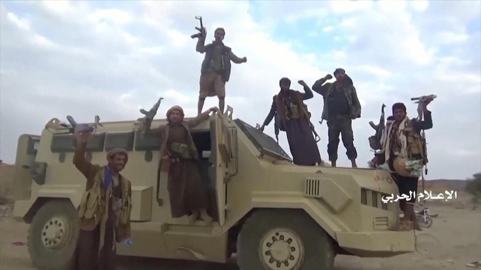 Houthi fighters pose on an alleged captured Saudi vehicle after an attack near the border with Saudi Arabias southern region of Najran in Yemen, in this still image taken from video on September 29, 2019. Houthi military officials claim that offensive defeated