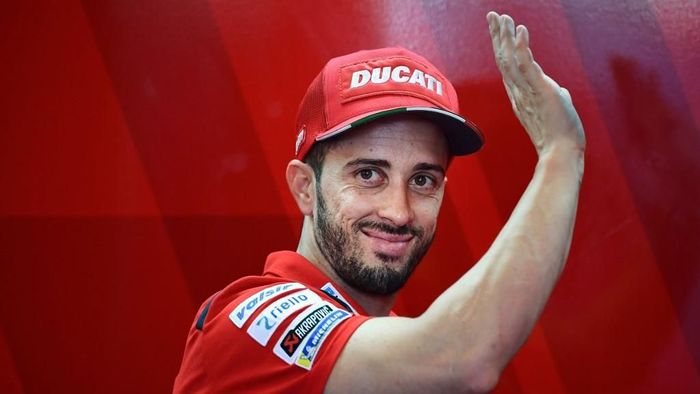 Ducati Team Italian rider, Andrea Dovizioso waves from the stands during a free practice session ahead of the San Marino MotoGP Grand Prix race at the Misano World Circuit Marco Simoncelli on September 14, 2019. (Photo by Marco Bertorello / AFP)