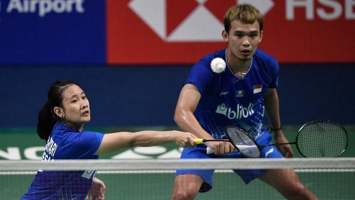Rinov Rivaldy/Phita Haningtyas Mentari bertekad persembahkan medali emas SEA Games 2019. (Jung Yeon-je / AFP)