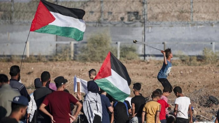 Warga Palestina (Foto: MAHMUD HAMS/AFP)