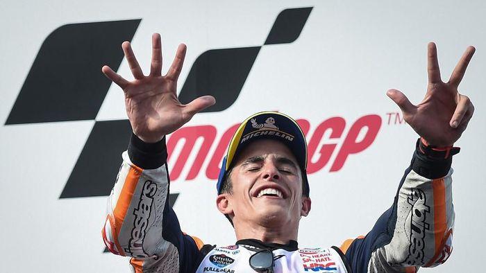 Marc Marquez sudah mengoleksi delapan gelar juara dunia. (Foto: Lillian Suwanrumpha/AFP)
