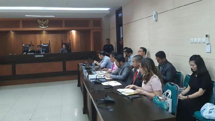 Hotman Paris kuasa hukum Grab Indonesia di sidang KPPU/Foto: Achmad Dwi Afriyadi/detikFinance