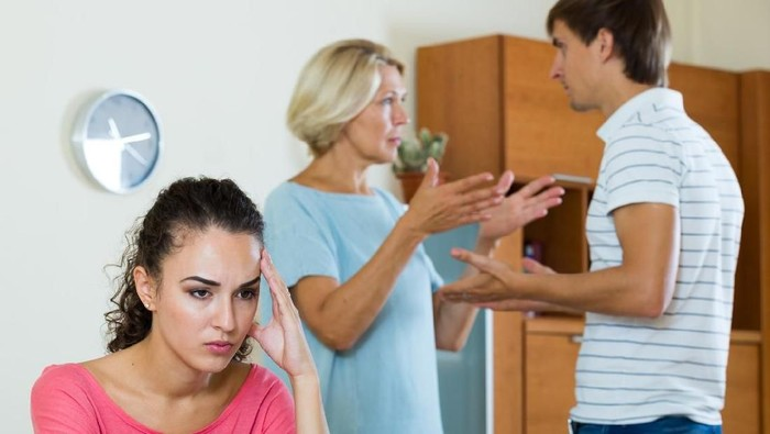 Upset girl apart from her husband and senior mother quarrelling