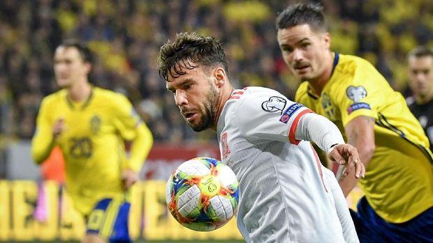 Spanyol baru bisa membobol gawang Swedia di menit-menit akhir.