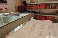 Jangan lupa registrasi dan bayar uang retribusi sejumlah Rp 10 ribu (Randy/detikcom)
