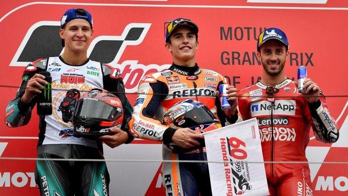 Marc Marquez semakin jauh meninggalkan rival-rivalnya di klasemen MotoGP usai menang di MotoGP Jepang (Foto: Toshifumi KITAMURA / AFP)
