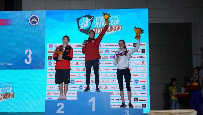 Aries Susanti Rahayu juara dunia empat kali dan pecah rekor. Semua dicatatkan di China (dok. FPTI)
