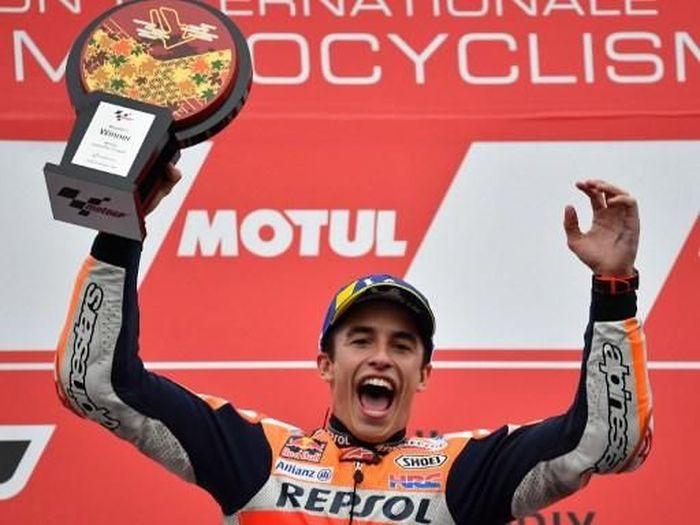 Pebalap Repsol Honda, Marc Marquez, menjadi rider pertama yang tembus 400 poin dalam satu musim MotoGP. (Foto: Toshifumi Kitamura/AFP)