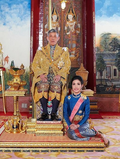 Thailands King Maha Vajiralongkorn and General Sineenat Wongvajirapakdi, the royal consort pose at the Grand Palace in Bangkok, Thailand,  in this undated handout photo obtained by Reuters August 27, 2019. Thailands King Maha Vajiralongkorn has stripped his newly named royal consort Sineenat of her titles and military ranks for being disloyal and conducting a rivalry with Queen Suthida, the palace said late on Monday.   Royal Household Bureau/Handout via REUTERS  ATTENTION EDITORS - THIS IMAGE WAS PROVIDED BY A THIRD PARTY. EDITORIAL USE ONLY. NO RESALES. NO ARCHIVE.