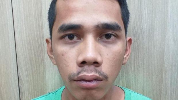 Salah satu pelaku yang ditangkap polisi.