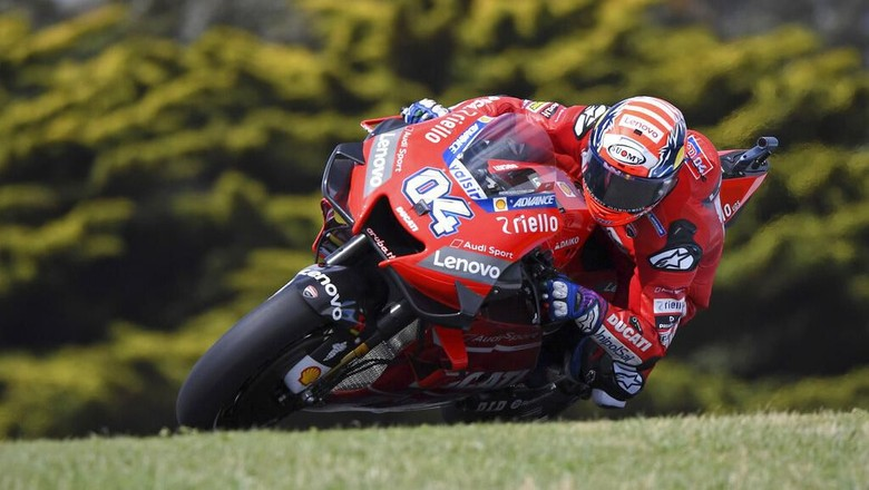 Ducati rider Andrea Dovizioso of Italy enters a turn during free practice at the Australian Motorcycle Grand Prix at Phillip Island near Melbourne, Australia, Saturday, Oct. 26, 2019. (AP Photo/Andy Brownbill)