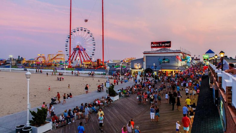 Ocean City, USA - August 4, 2014: Crowded boardwalk in Ocean City, MD on August 4, 2014. National Geographic named it one of the top 10 boardwalks in USA and The Travel Channel called it Americas best.