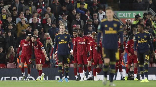 Liverpool ke perempat final usai mengalahkan Arsenal melalui drama adu penalti. (