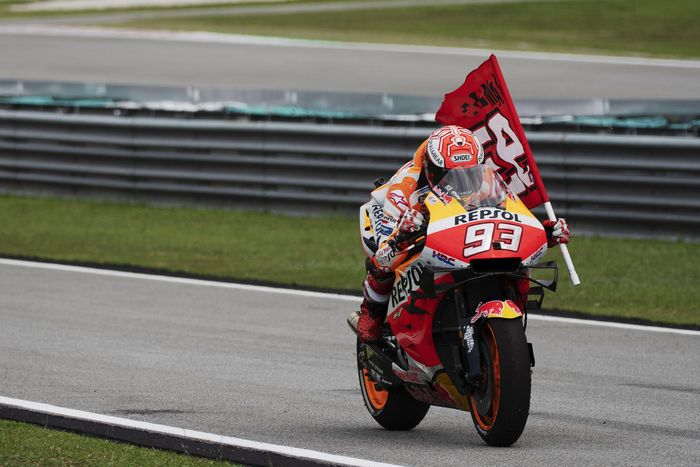 KUALA LUMPUR, MALAYSIA - NOVEMBER 03: Marc Marquez of Spain and Repsol Honda Team  celebrates with flag at the end of the MotoGP race during the MotoGP of Malaysia - Race at Sepang Circuit on November 03, 2019 in Kuala Lumpur, Malaysia. (Photo by Mirco Lazzari gp/Getty Images)