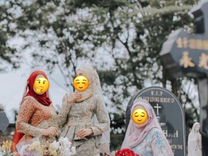 Sesi pemotretan memakai gaun pengantin hijab di pemakaman. Foto: Dok. Instagram @pencetusummah_amin