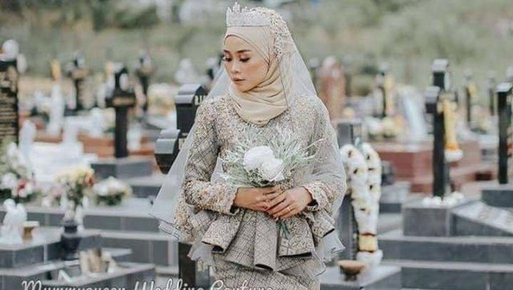 Viral Model Hijab Foto Pakai Gaun Pengantin di Kuburan, Dihujat Netizen