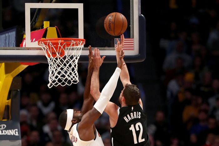 DENVER, COLORADO - NOVEMBER 14: Joe Harris #12 of the Brooklyn Nets takes the ball to the basket against Paul Millsap #4 of the Denver Nuggets in the first quarter at the Pepsi Center on November 14, 2019 in Denver, Colorado.  NOTE TO USER: User expressly acknowledges and agrees that, by downloading and or using this photograph, User is consenting to the terms and conditions of the Getty Images License Agreement.  (Photo by Matthew Stockman/Getty Images)