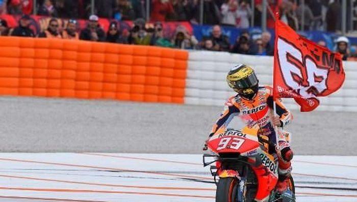 Marc Marquez menutup musim dengan kemenangan di MotoGP Valencia. (Foto: JOSE JORDAN / AFP)