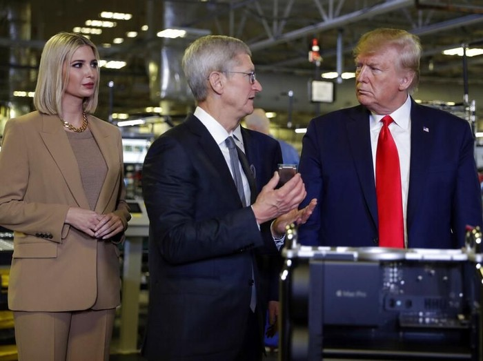 President Donald Trump tours an Apple manufacturing plant, Wednesday, Nov. 20, 2019, in Austin with Apple CEO Tim Cook, Ivanka Trump, the daughter and adviser of President Donald Trump and others. (AP Photo/ Evan Vucci)