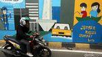 Mural Siaga Banjir Mejeng di Pintu Air Manggarai