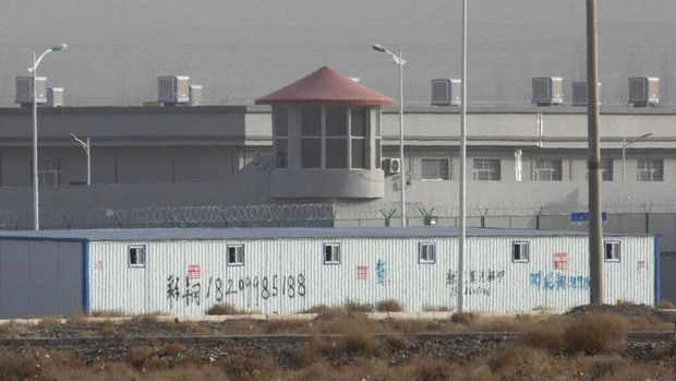 FILE.- In this Monday, Dec. 3, 2018, file photo, a guard tower and barbed wire fences are seen around a facility in the Kunshan Industrial Park in Artux in western China's Xinjiang region. This is one of a growing number of internment camps in the Xinjiang region, where by some estimates 1 million Muslims are detained, forced to give up their language and their religion and subject to political indoctrination. Highly confidential blueprint documents leaked to a consortium of news organizations lay out the Chinese government's deliberate strategy to lock up ethnic minorities to rewire their thoughts and even the language they speak.(AP Photo/File)