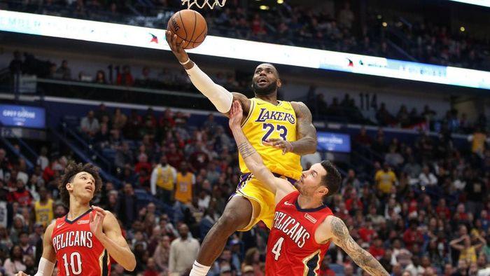 LeBron James berhasil menorehkan rekor mencetak 33.000 poin di NBA (Foto: Chris Graythen/Getty Images)