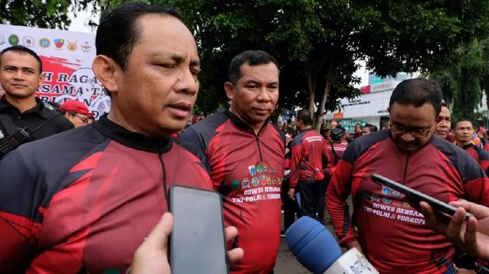 Kapolda Metro Jaya, Pangdam Jaya, dan Gubernur DKi Jakarta berolahraga. (Foto: M Rizky Pratama)