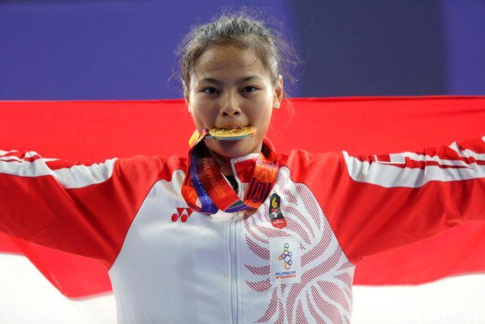 Lifter muda Windy Cantika Aisah sukses meraih medali emas di SEA Games 2019 Filipina.